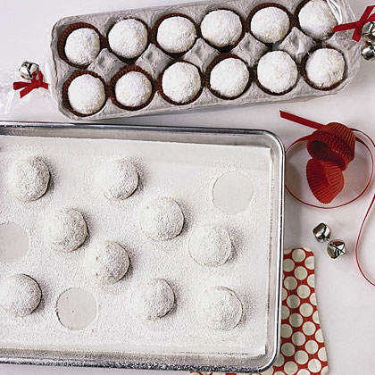 powdered sugar covered cookies in an egg carton