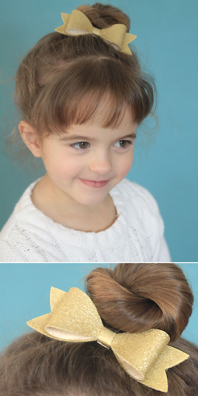 A little girl with a gold bow in her hair