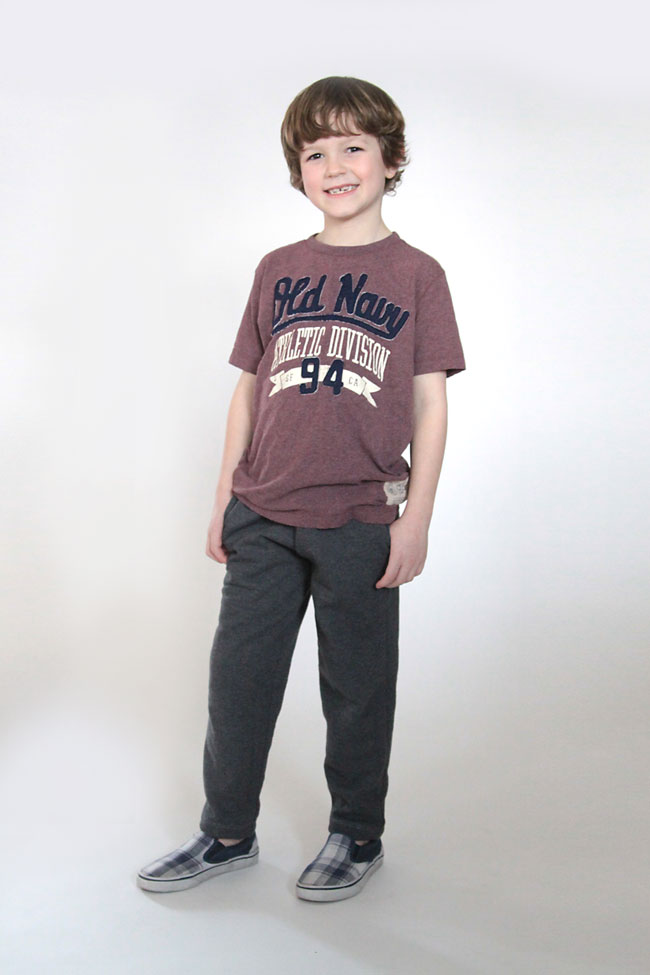 A young boy wearing a pair of slim fit sweats