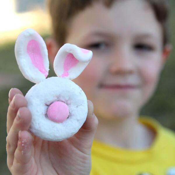 A boy holding a mini donut bunny