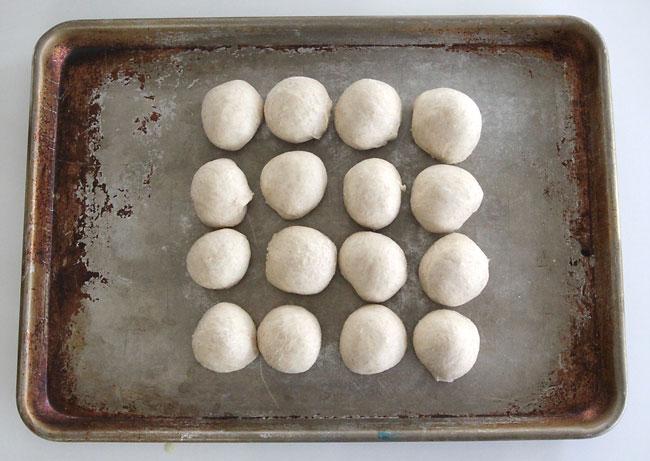 Balls of roll dough on a baking sheet