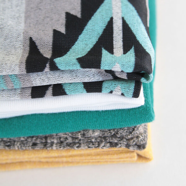 how to sew with sweater knits - lots of great tips and tricks for sewing with sweater fabric
