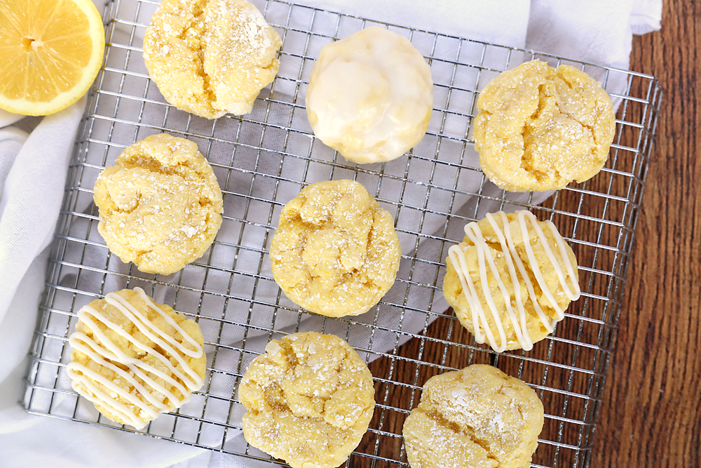 Lemon cookies on a cooking rack, some with glaze