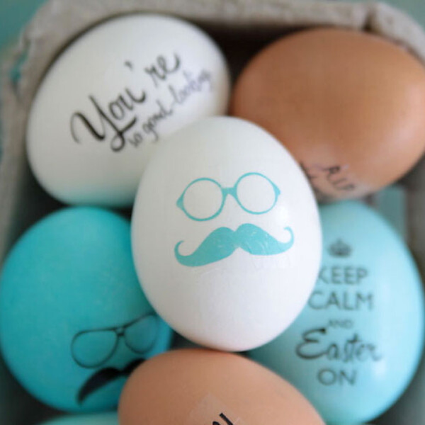 Easter eggs decorated with image of glasses and mustache