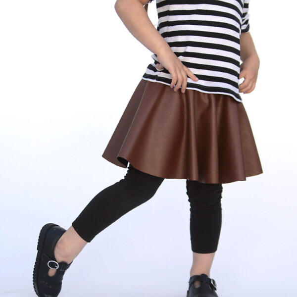 A girl wearing a circle skirt made from faux leather