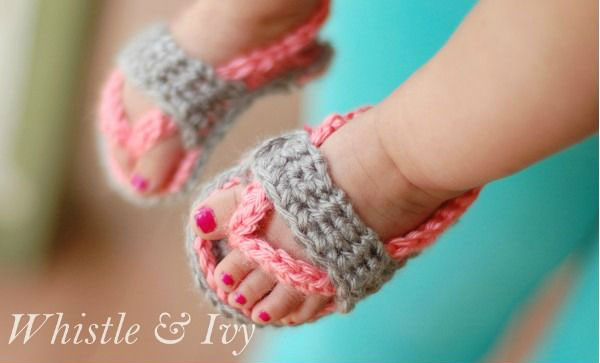 Baby feet with crocheted sandals