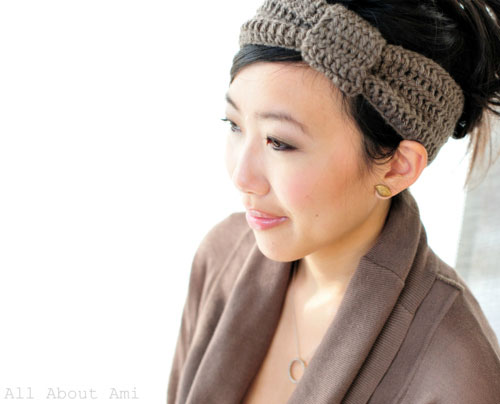 A person wearing a crocheted headband