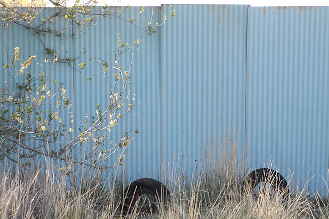 A blue corrugated wall