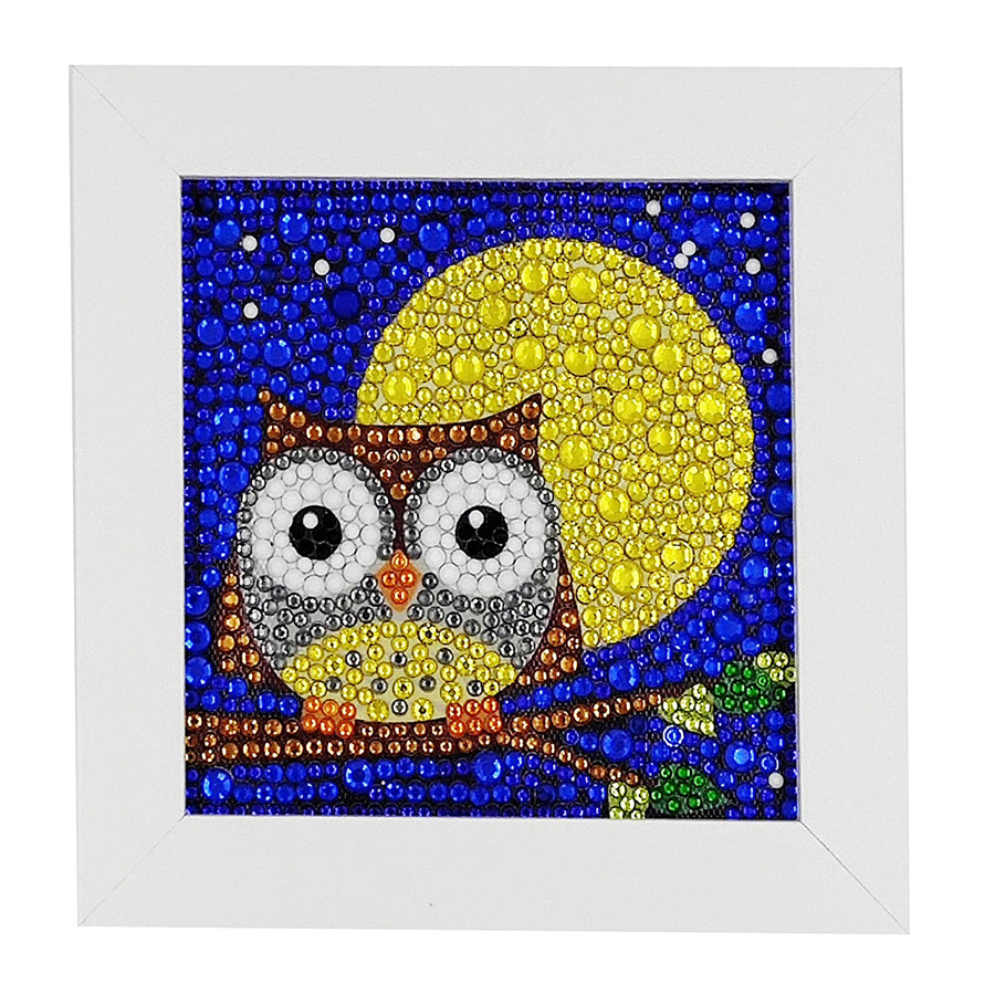 Photo of an owl in front of the moon created with gem art