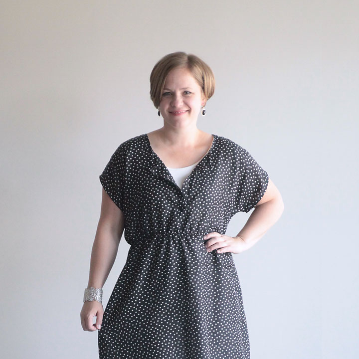 A woman wearing a dress made from a t-shirt pattern