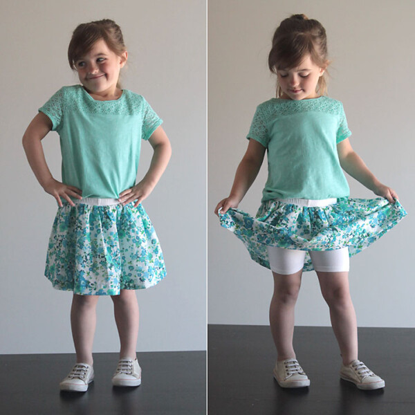 A little girl wearing a skirt with attached shorts