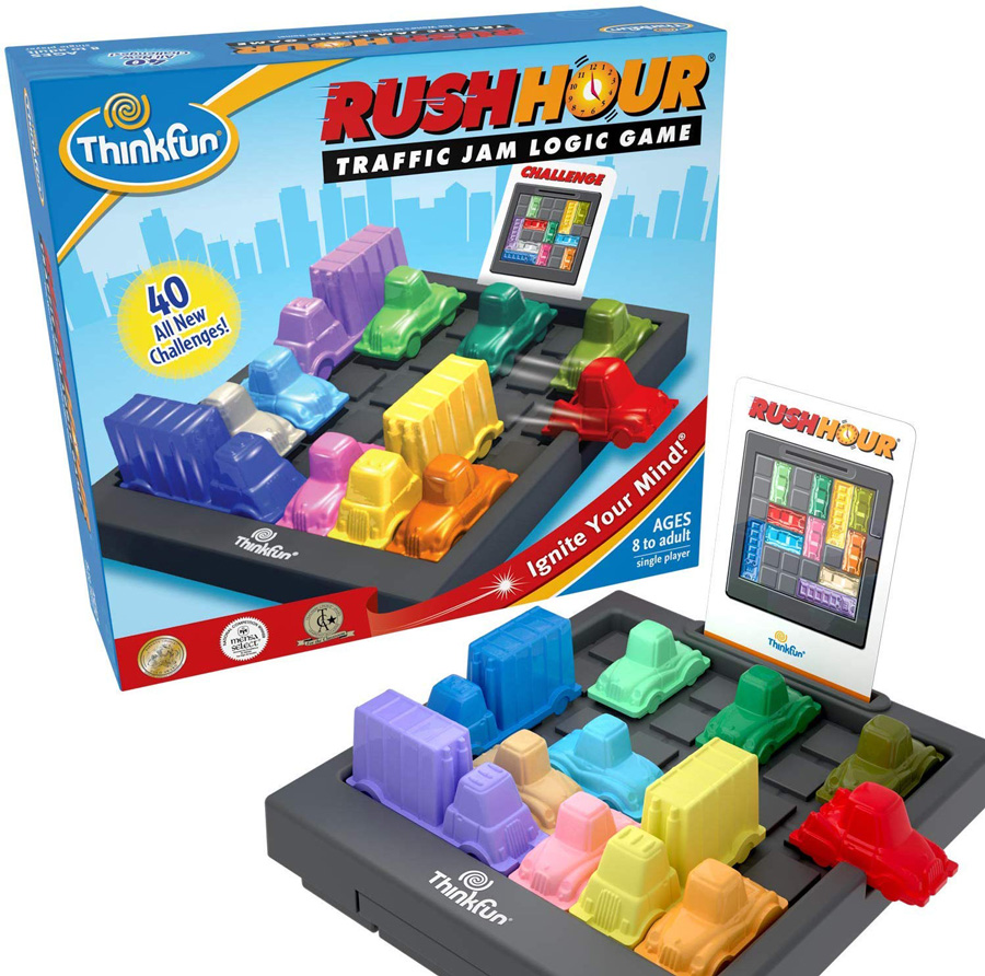 Photo of the Rush Hour game with small plastic cars that can be moved on a platform