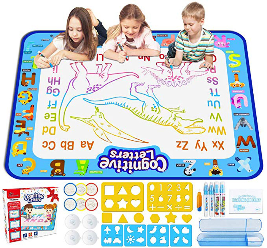 Children on a mat with letters and dinosaurs drawn on it