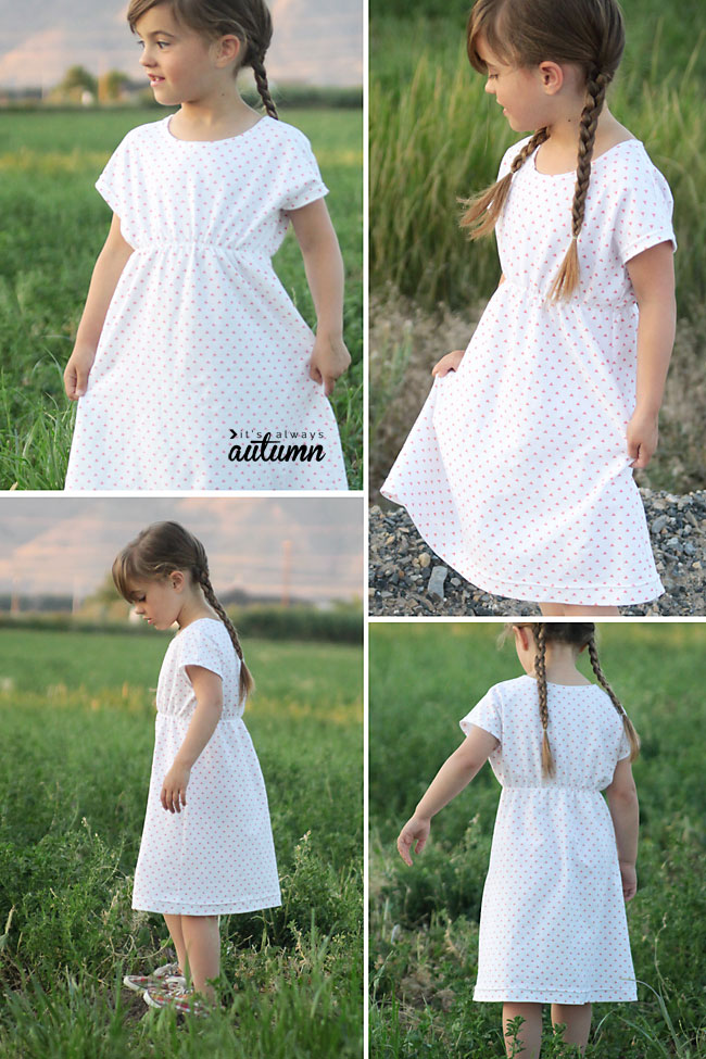 A little girl that is standing in the grass wearing a play dress made from a sewing pattern