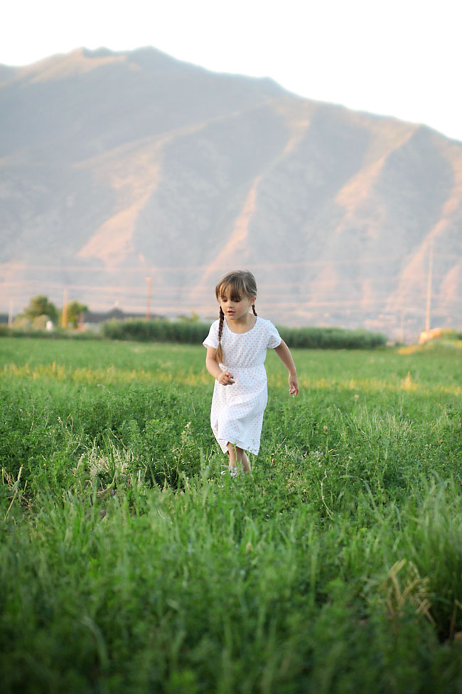 A little girl playing in a field