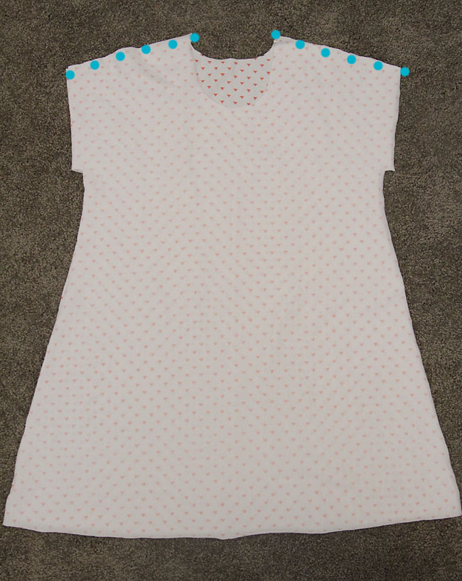 Play all day dress front and back with shoulder seams marked