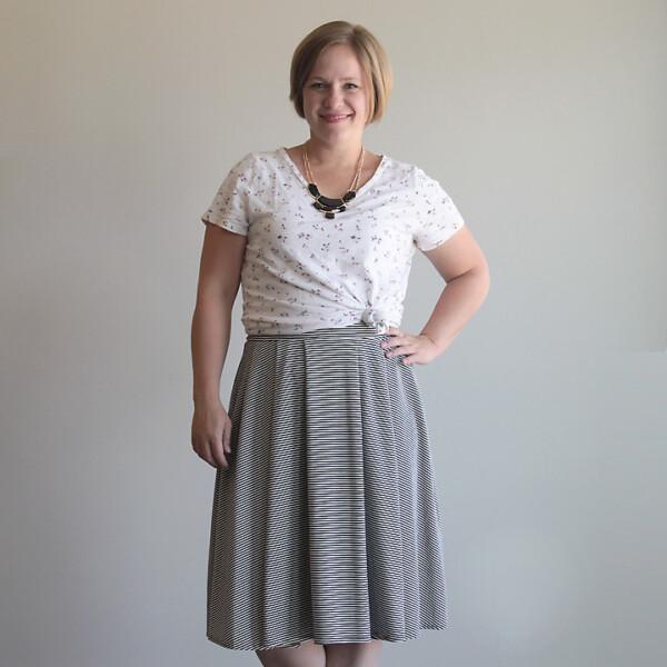 Woman wearing pleated midi length skirt