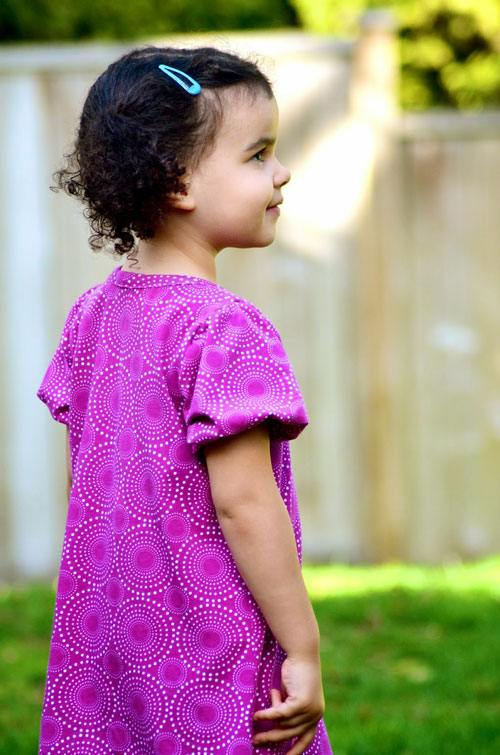 A little girl wearing a pink dress