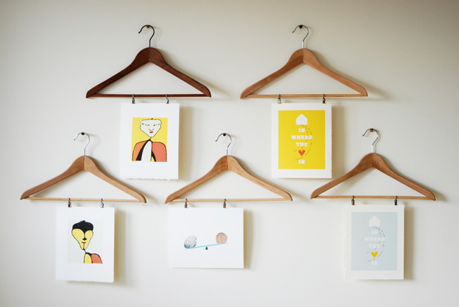 DIY photo display using prints hung from wood clothes hangers