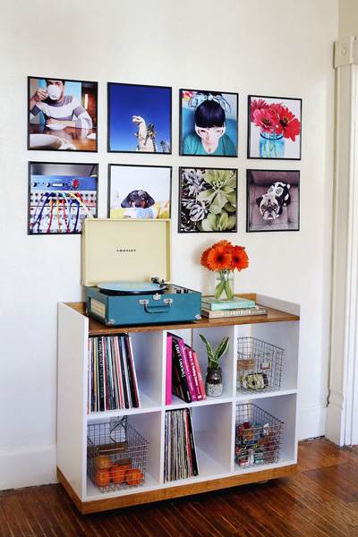 Large photos in record frames on a wall