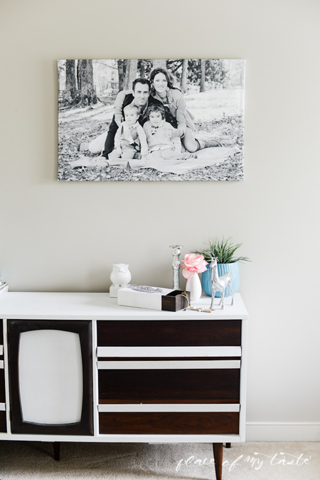 Large wrapped canvas family photo hanging on a wall