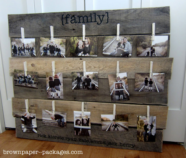 Photo display made from wood strips with clothespins to hold pictures