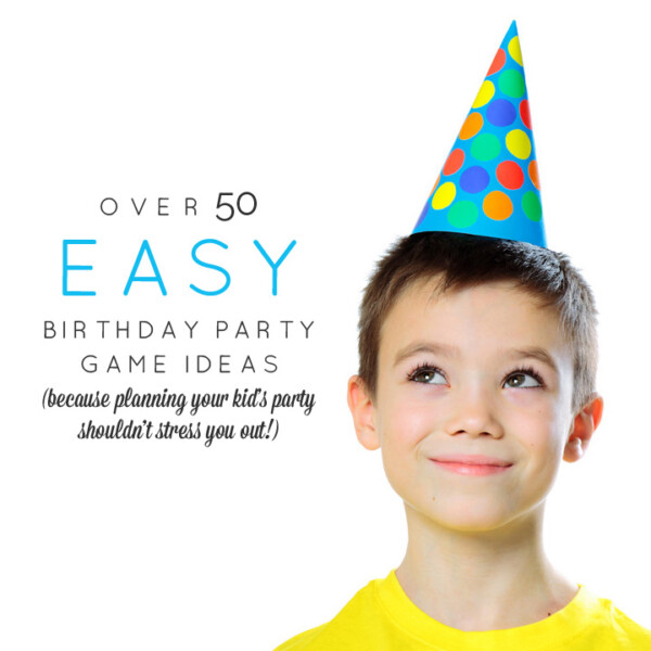 A young boy wearing a birthday hat and smiling at the camera