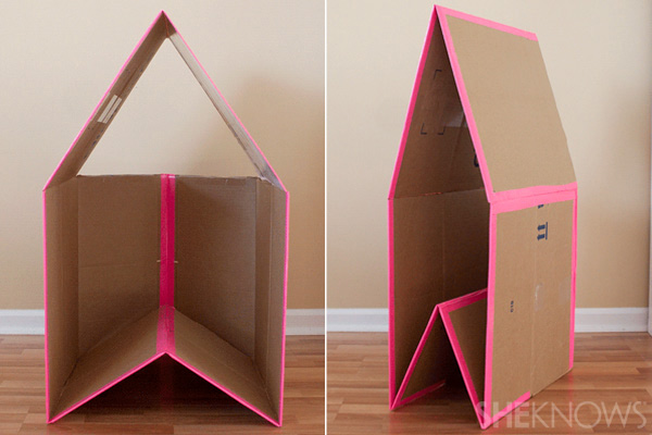 A collapsible play house made from a large cardboard box and duct tape
