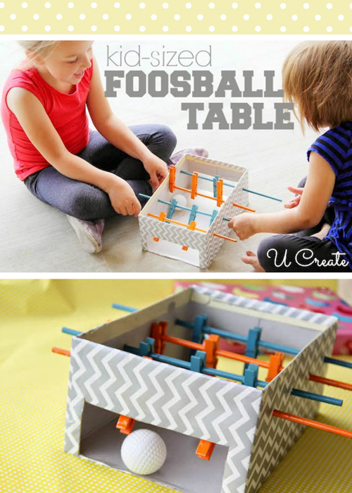 Kids playing with a foosball table toy you can make from cardboard box