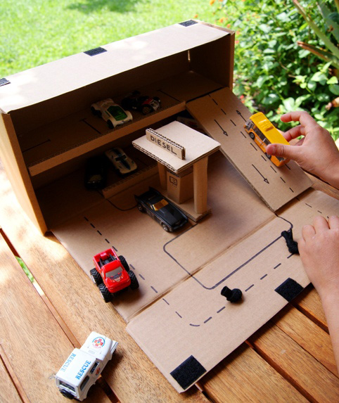 A cardboard garage for toy cars