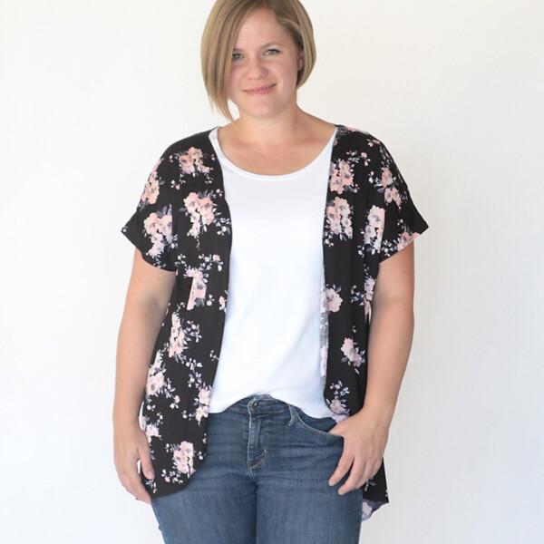 A woman wearing an open t-shirt shawl