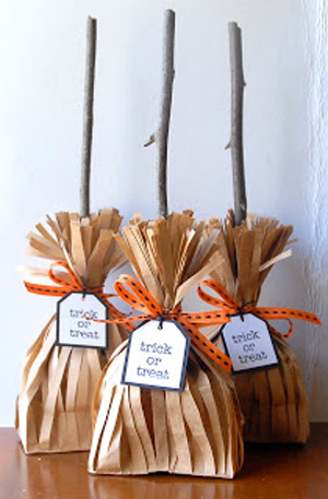 Halloween treat bags that look like witches brooms made from brown lunch sacks and sticks