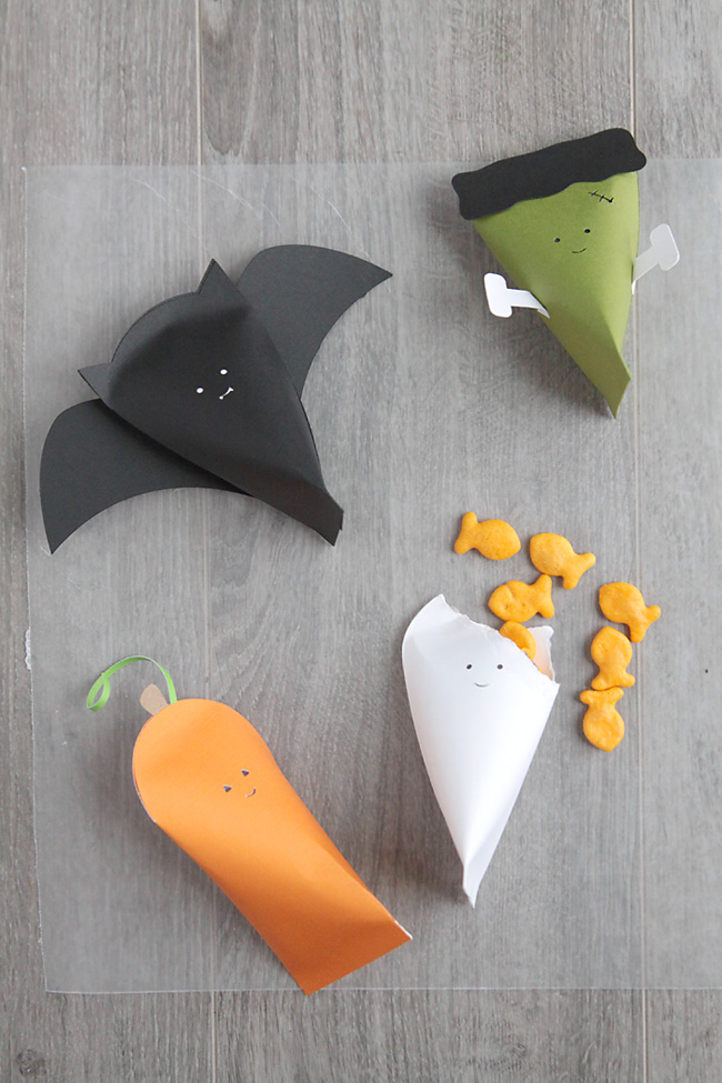 paper halloween character boxes with goldfish crackers in them