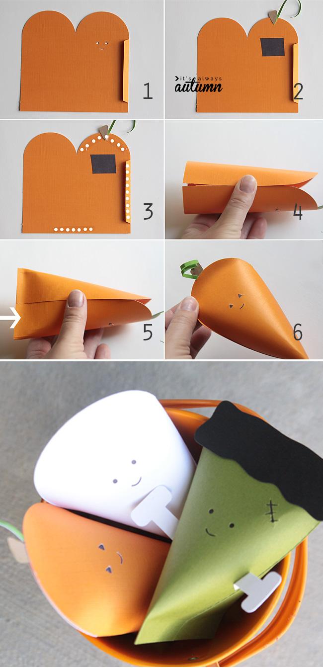 Folding a Halloween pumpkin goodie box cut from orange paper