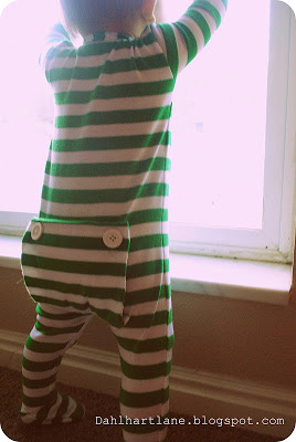 Little boy in striped pajamas with back flap