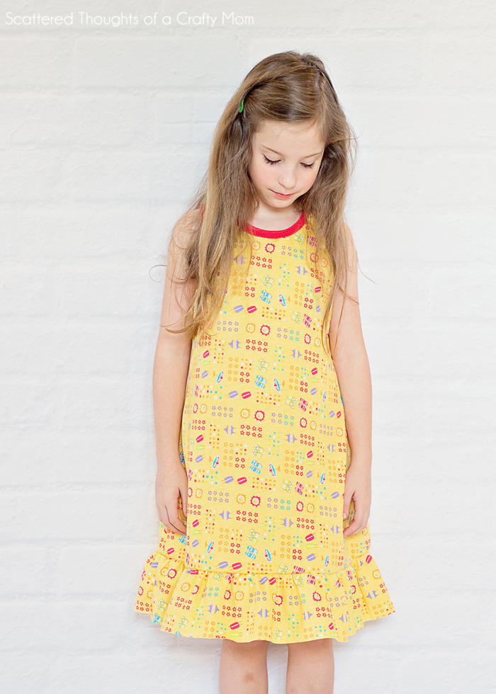 A young girl in a yellow nightgown