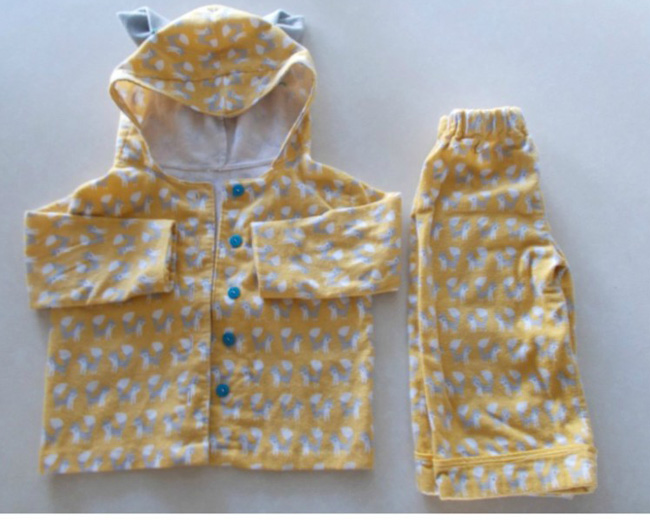 Little kid pajamas made from yellow fabric