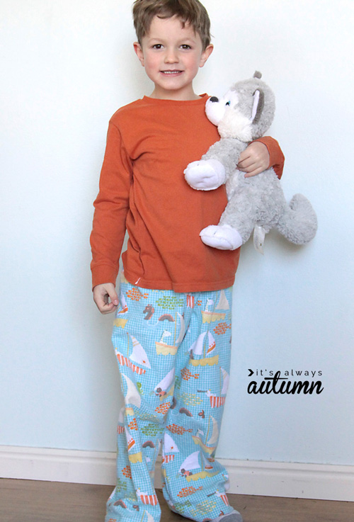 A little boy wearing pajamas made from a free sewing tutorial