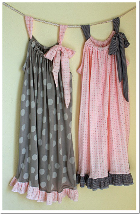 Pillowcase style nightgowns hanging on a wall