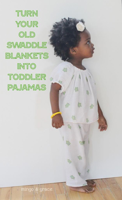 A little girl wearing pajamas made from swaddle blankets