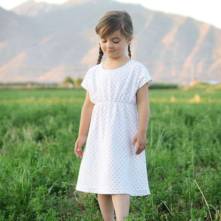 A little girl wearing a nightgown made from a free sewing pattern