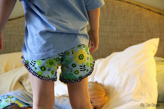A kid wearing pj shorts with ruffled trim
