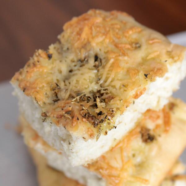 A close up of a piece of focaccia bread