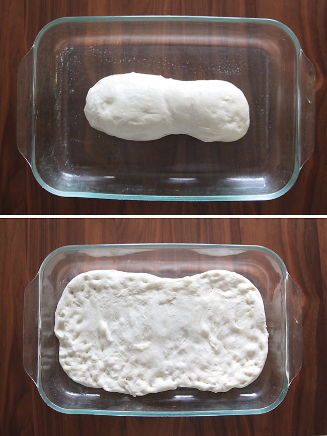 A loaf of frozen bread dough in a 9x13 pan, thawed dough pressed out to fill 9x13 pan
