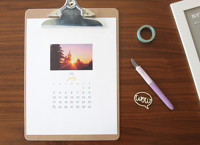 Photo calendar on a clipboard, tape, exacto knife