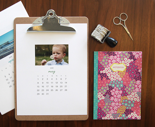 Printable photo calendar on a clipboard, journal, date stamp, scissors