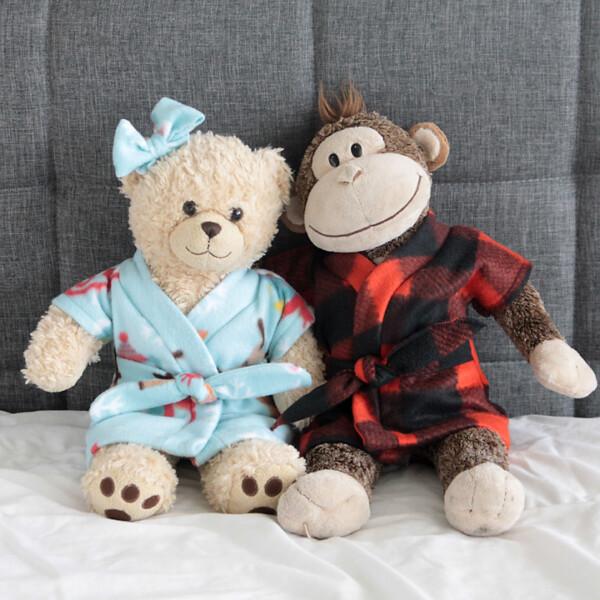 Teddy bears wearing fleece robes