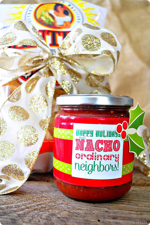 Chips and a jar of salsa with tag saying Happy Holidays nacho ordinary neighbors!