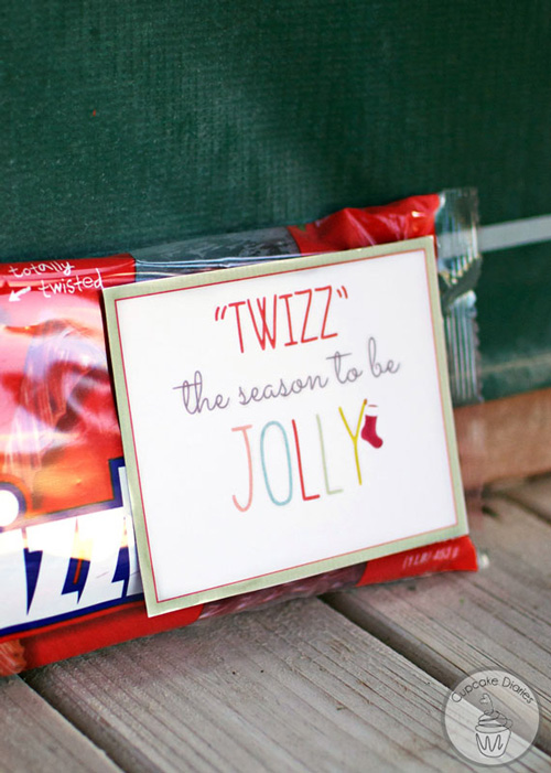 """Package of twizzlers with tag that says \""""twizz\"""" the season to be jolly"""