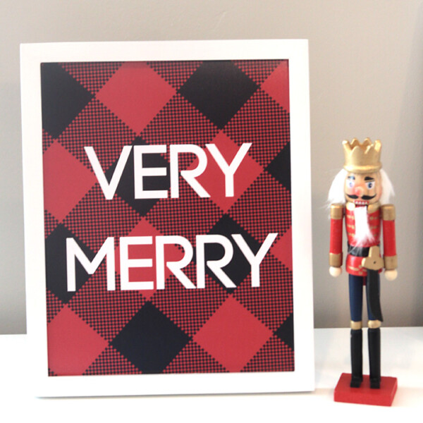 Christmas print with words Very Merry on red and black plaid background